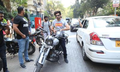 Kartik Aaryan passionately rides his bike in Mumbai