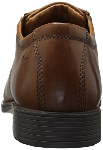 Clarks Men's Tilden Cap Oxford Shoe,Dark Tan Leather Comfort Features: Ortholite Footbed, Smooth Fabric and PU Linings, Durable TPR Outsole Stretch Gore Panels for a Flexible Fit Premium Full Grain Leather Heel Height 1 inch Ultra-Lightweight A traditional captoe derby crafted from wealthy, full grain leather-based. The Tilden Cap by Clarks Collection options discreet elastic gore panels for a better match with out distracting from its elevated profile. Inside, an impact-absorbing OrthoLite footbed reduces the shock of each step, whereas the versatile TPR outsole supplies light-weight grip.