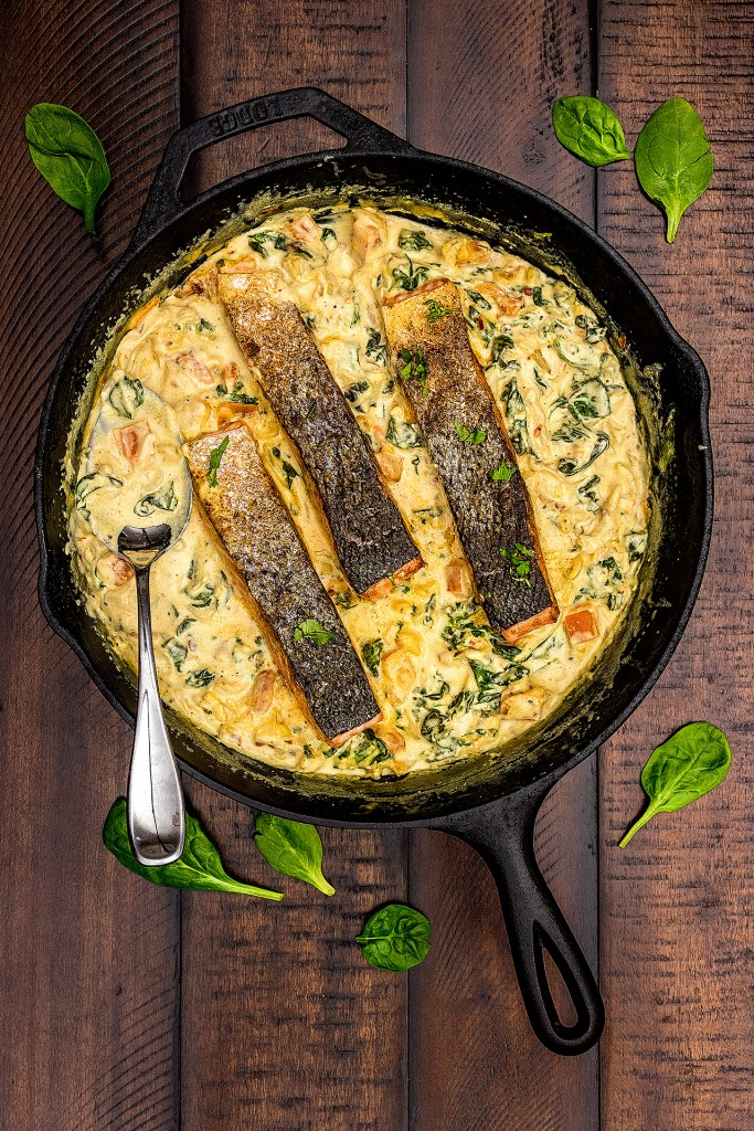 Crispy pan seared salmon in a creamy curried spinach sauce. Perfect for weeknights, this deliciously easy, restaurant style meal is ready in 30 minutes!