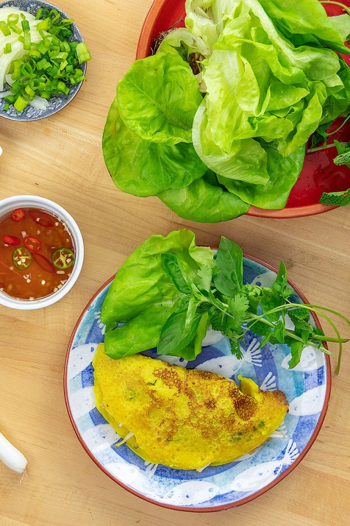 Banh xeo with lettuce and nuoc cham