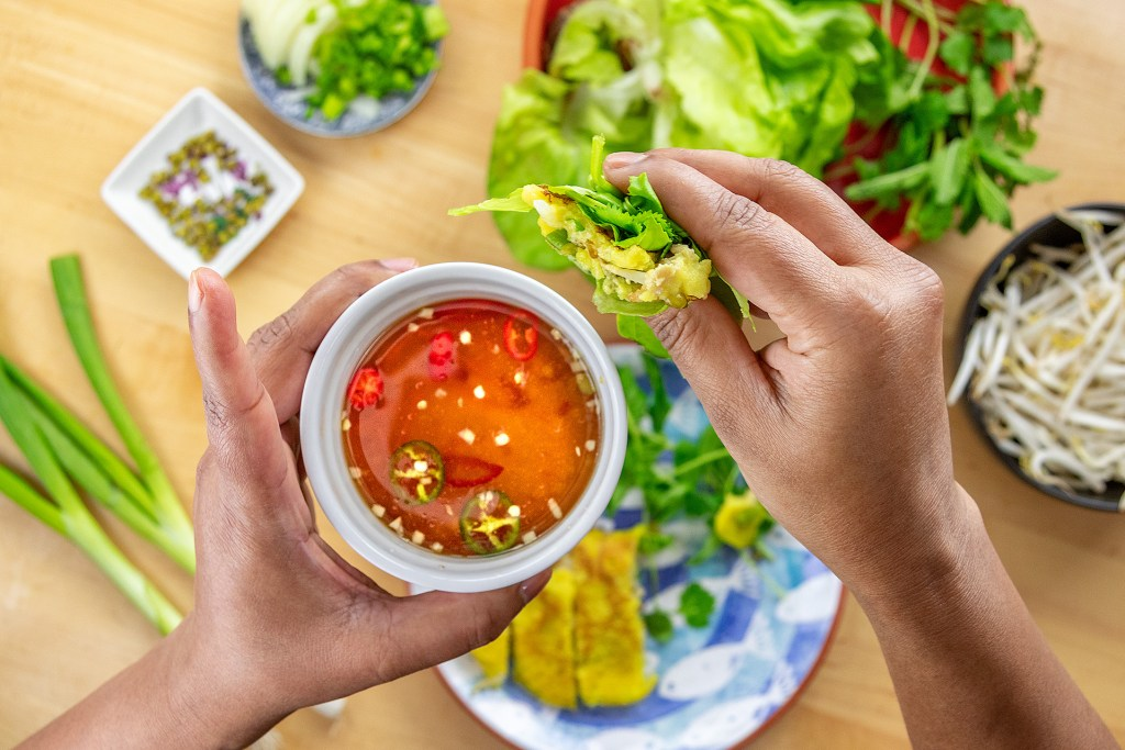 How to eat Banh Xeo Step 4