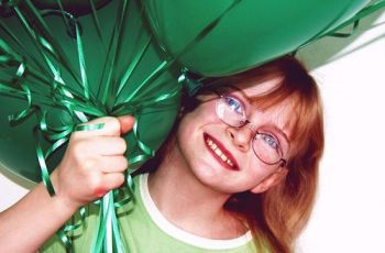 Happy Girl With Green Party Balloons