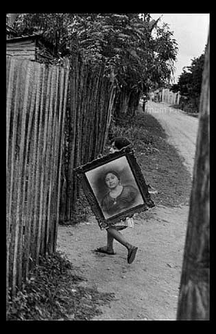 Henri Cartier Bresson child carrying painting