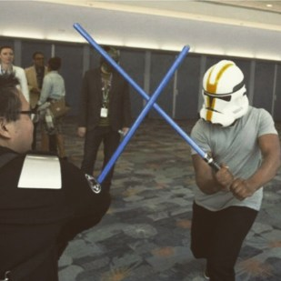 """john_boyega: """"Lightsaber fight with SW fan at convention...blending in nicely."""""""