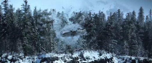The Falcon crashing through trees on the snow planet.