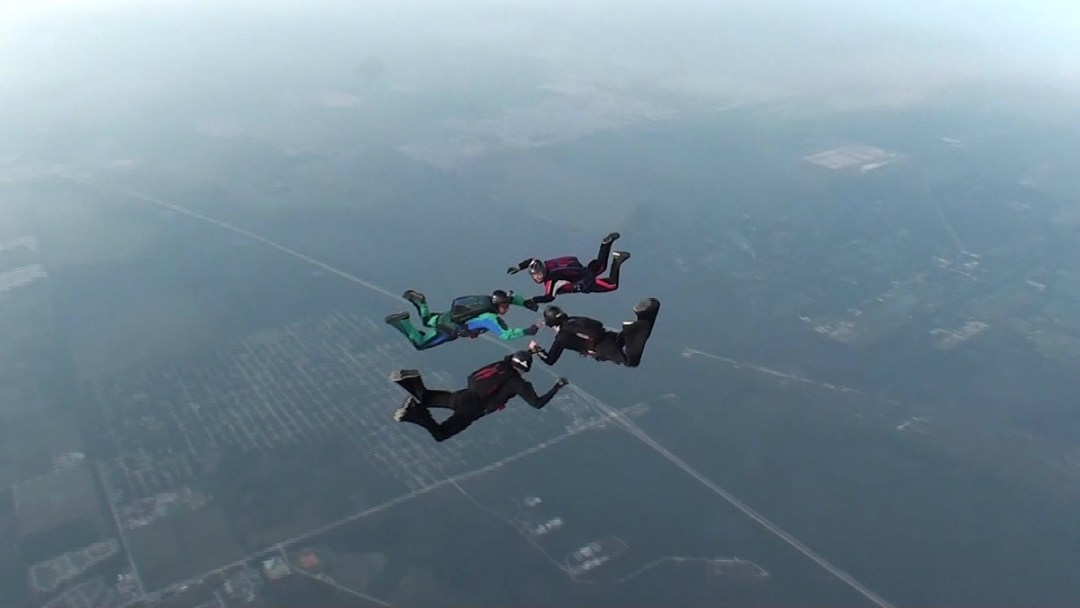 4 way skydiving formation over the city of Sebastian