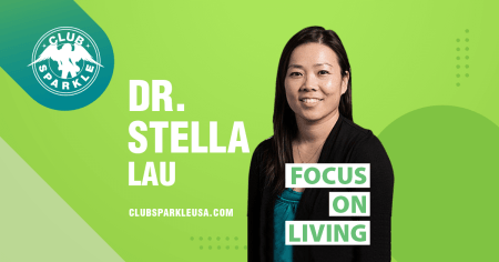 """An image of Doctor Stella Lau wearing a black jacket over a green blouse with the words """"Focus on Living"""" superimposed over her."""