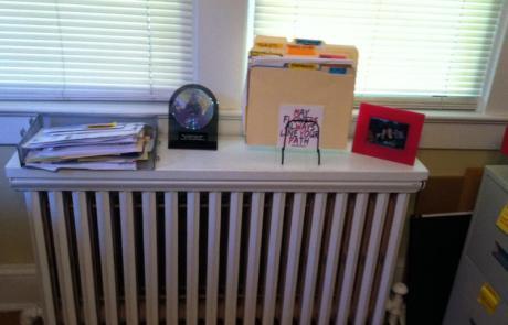 Radiator shelf, decluttered and organized