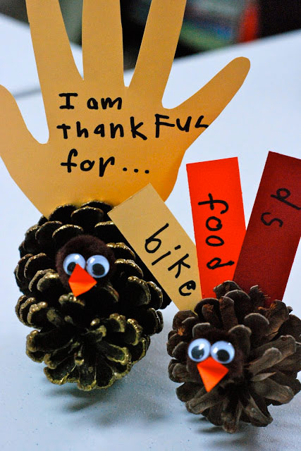 Have your kids write out what they're thankful for on strips of colored paper. Each one will be attached to a pinecone turkey for an interactive centerpiece that reminds guests of Thanksgiving's true meaning.  Get the tutorial at Creating Couture Parties.