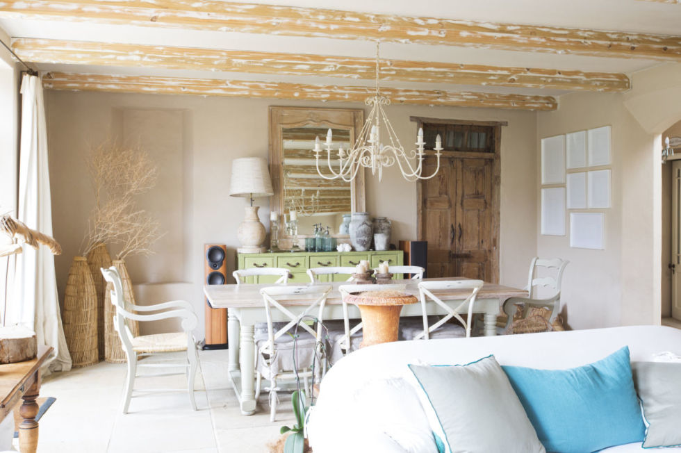 Distressed wood beams draw the eye to the ceiling in this airy yet cozy space.