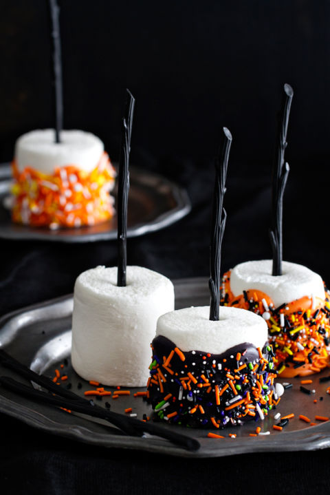 For wicked broomstick pops, dip marshmallows in melted chocolate candy and add festive sprinkles. Get the recipe at My Baking Addiction.