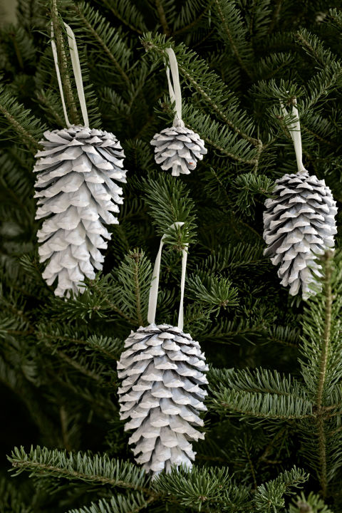 Spray-painted white, pinecones really pop against evergreen boughs. RELATED: Easy, Homemade Christmas Ornaments