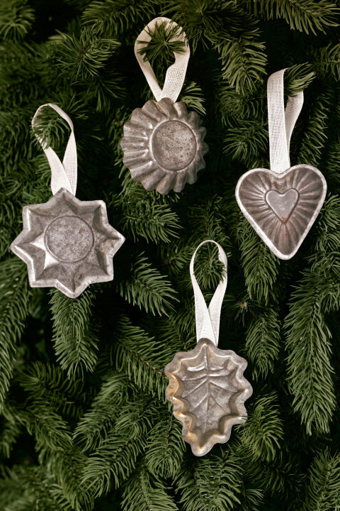 Vintage baking molds add a sweet touch to any tree; simply hot-glue ribbon loops to their backs and hang.