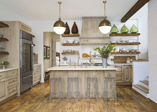 If you can't get enough of the reclaimed-wood look, here are two words you'll be hearing a lot: pecky cypress. Seen here on the hood and island, it's a type of wood that has a grainy texture thanks to long, narrow burrows or cavities. Bonus idea: From boxy appliances and islands to linear shelves, kitchens tend to have a lot of straight lines. Soften the room with orb lights.