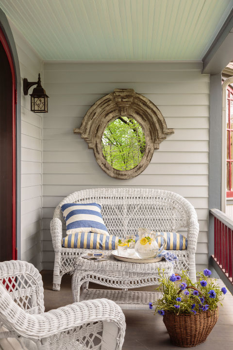 The wicker patio set was a hand-me-down from a friend of the owner of this Arkansas home. Another pal sewed the love seat's cushion and pillow from fabric the owner scored at Jo-Ann.