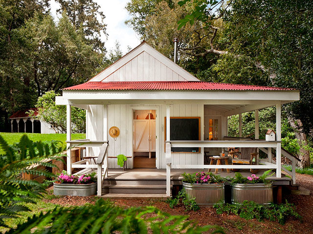 Though it clocks in at just 260-square-feet, this cottage's bright and colorful design exudes a cheery atmosphere from all corners. Designed by Richardson Architects, the tiny structure is situated on a dairy farm near the Northern California coastline and was constructed using non-corrosive and wear-resistant materials. The exterior features a large wraparound porch, a chalkboard, and ample seating, while the interior is filled with bright red and yellow hues.<br /><br /><br /><br /><br /><br /><br /><br /><br /><br /><br /><br /><br /><br /><br /><br /><br /><br /><br /><br /><br /><br /><br /><br /><br /><br /><br /><br /><br /><br /><br /> Look inside this cheery Northern California cottage.
