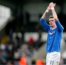 Kyle Lafferty consoles fans outside Rugby Park after Kilmarnock Relegation