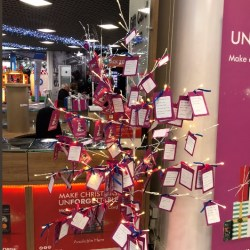 Generous shoppers help children through a 'Giving Christmas Tree'