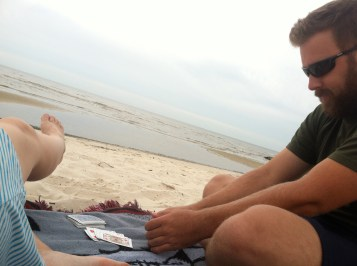 playing cards on the Mississippi shore