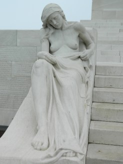 Young woman to the left of steps at Vimy Ridge