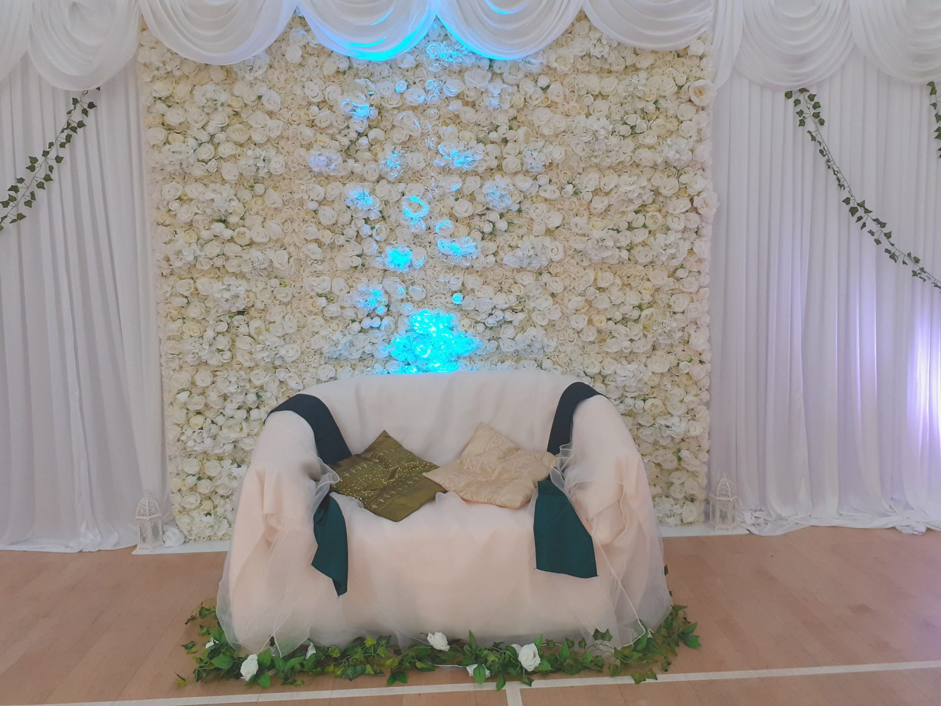 Decorated Chair with Backdrop and Flower Wall with Giant Gestures