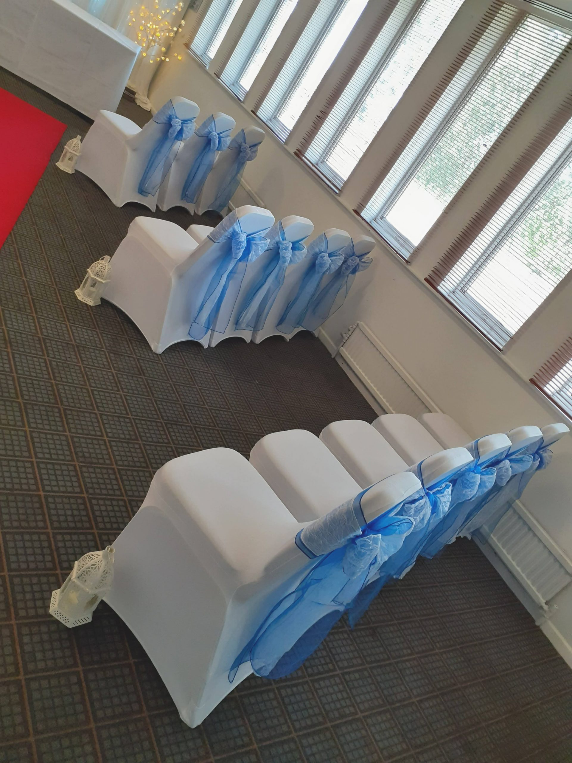 Chair Covers, Blue and white lace sash and Lanterns at Holiday Inn
