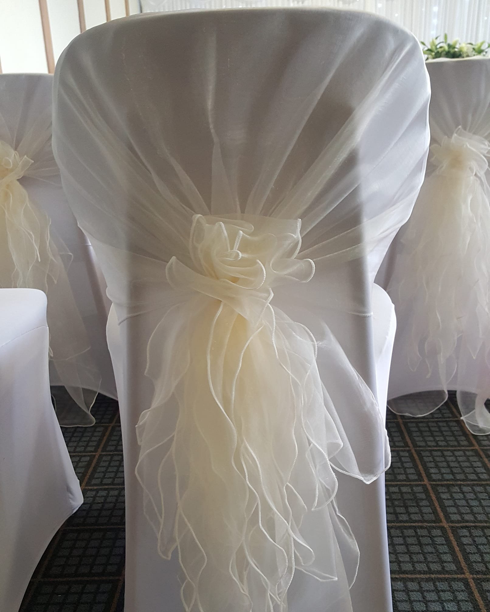 White Chair Covers with Cream Sashes