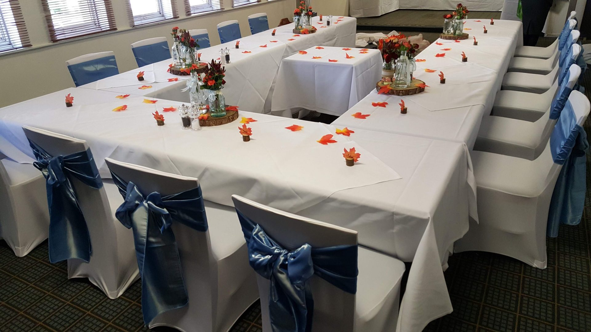 Blue Sashes with Leaves and autumn inspired Table decorations