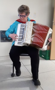 Dr. Wendy Stewart playing the accordion