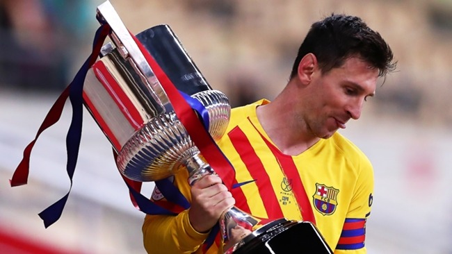 Barcelona forward Lionel Messi with the Copa del Rey trophy