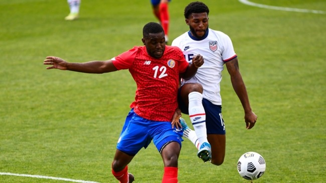 Joel Campbell of Costa Rica and Mark McKenzie of USA fight for the ball
