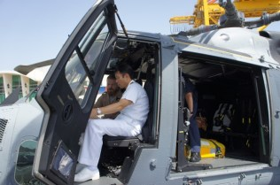 RADM Fukuda sits inside a Royal Navy Wildcat helicopter