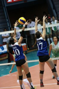 Tejada and Bea Tan defending the net for the Lady Eagles