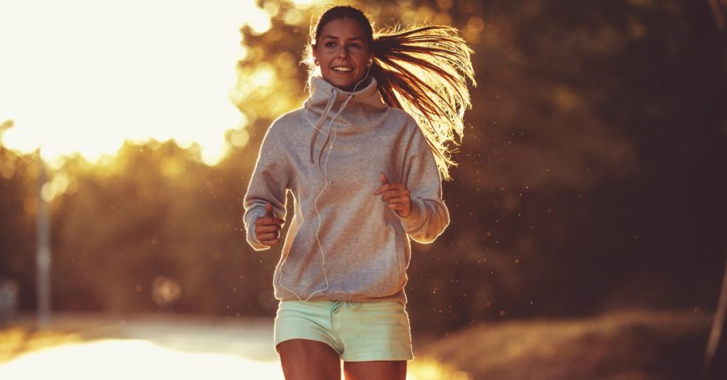 woman running backlit by sun