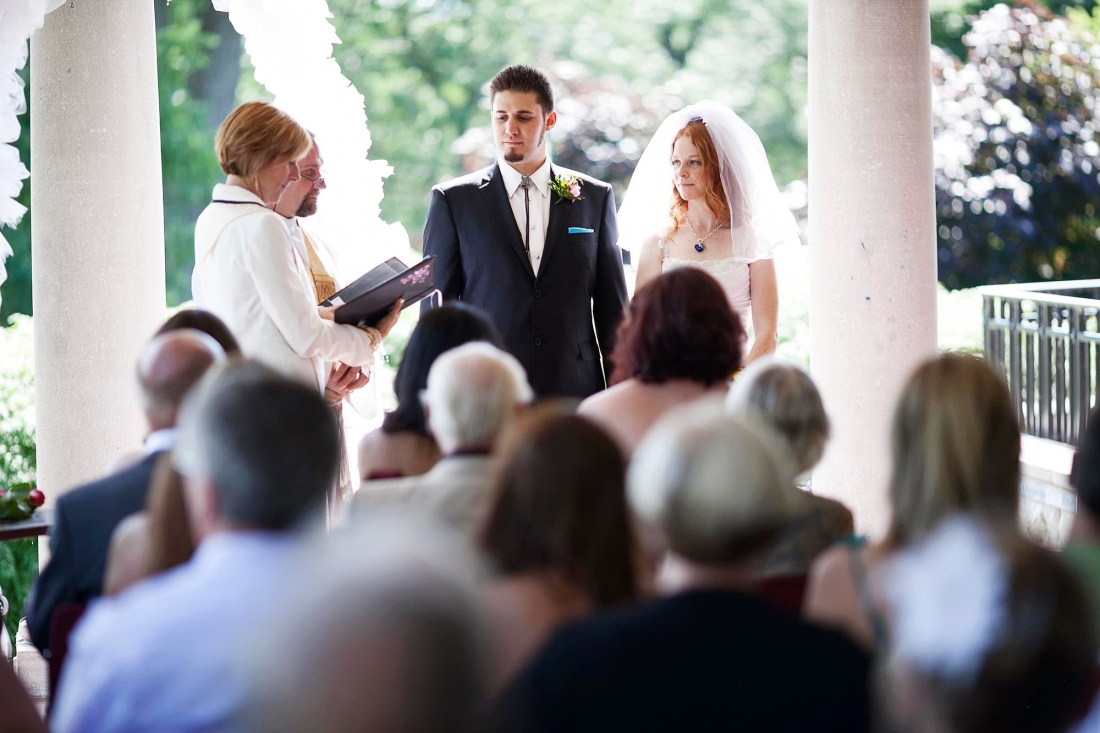 A bride and groom during their wedding ceremony.