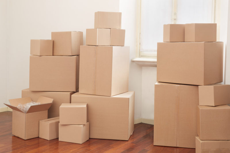 Cardboard boxes in a small apartment, moving day