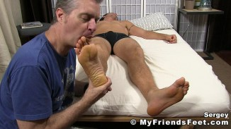 man licking foot