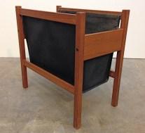 Vintage teak and black leather magazine rack, 3/4 view.
