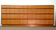 "HOLMEGAARD 9-drawer teak platform-base dresser, front view, excellent condition, 30H x 72""W x 19""D."