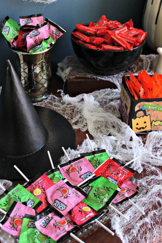 This Halloween Candy Bar would work out awesome for a Halloween party, less so for trick-or-treaters. You can easily decorate for various party themes!