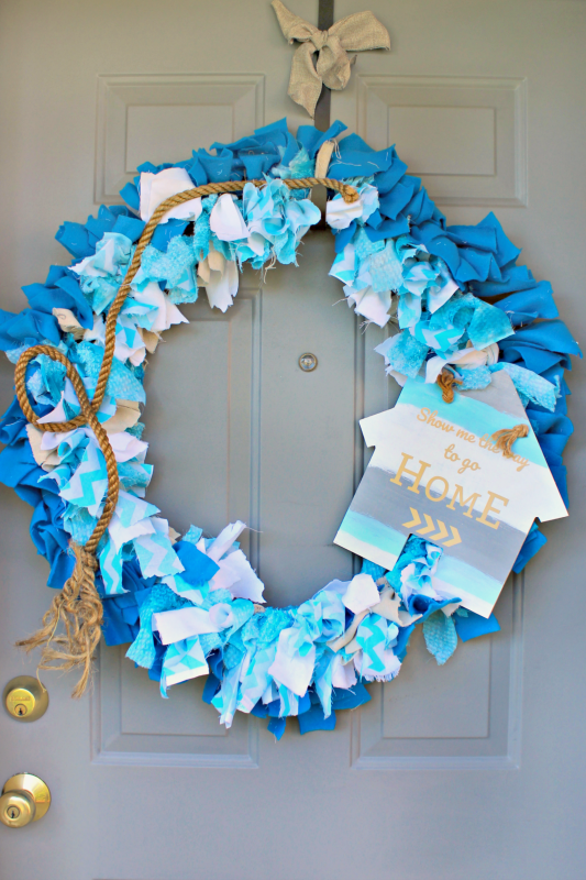 Inspired by the classic film JAWS, I used the ocean and one of my favorite quotes to create this fabric rag wreath for my front door! Come see how I took fabric scraps, wood, rope, and vinyl and created a nautical summer wreath! #MovieMondayChallenge