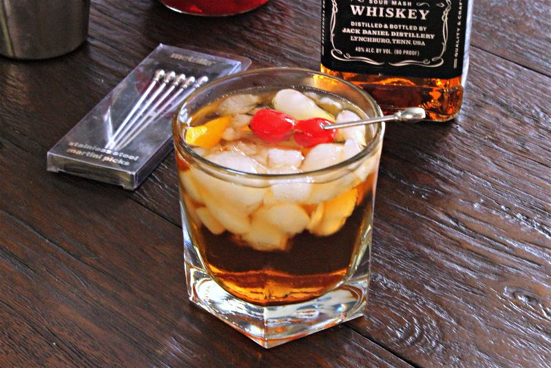 The classic Manhattan cocktail recipe can be easily made at home with Jack Daniels whiskey and garnished with boozey cherries.