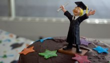 Cheering student on graduation cake