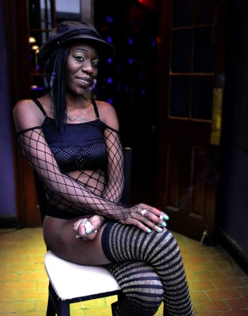 """Danielle Veenstra, College of Central Florida (Rob Marino, adviser) — Keasha Smith, dancer at The Harem, a gentlemen's club, sits outside on her smoke break; both relaxing and enticing new customers. Smith has worked hard her entire life in order to survive and she appreciates attitude and gutsiness when she sees it. The Chicago native lets everyone know that """"No couples are allowed, only single people are welcome."""""""
