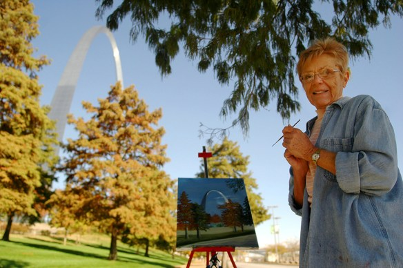FIRST PLACE: Photo by Annabelle Ombac, Virginia Tech University (Kelly Wolff, adviser) — A local woman paints a picture of famous St. Louis Arch on the Mississippi River bank.