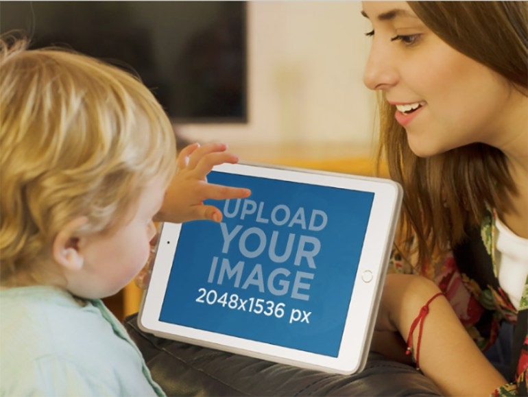 Mockup of Young Mom and Son Interacting with White iPad
