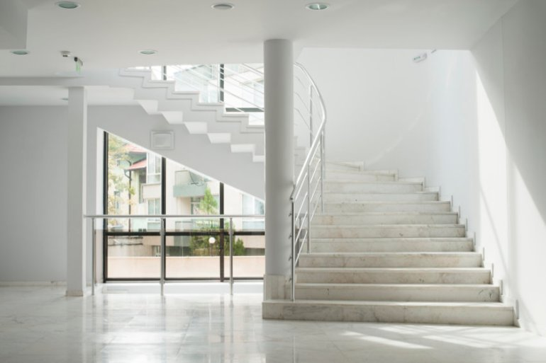 empty marble staircase in a stark white modern building