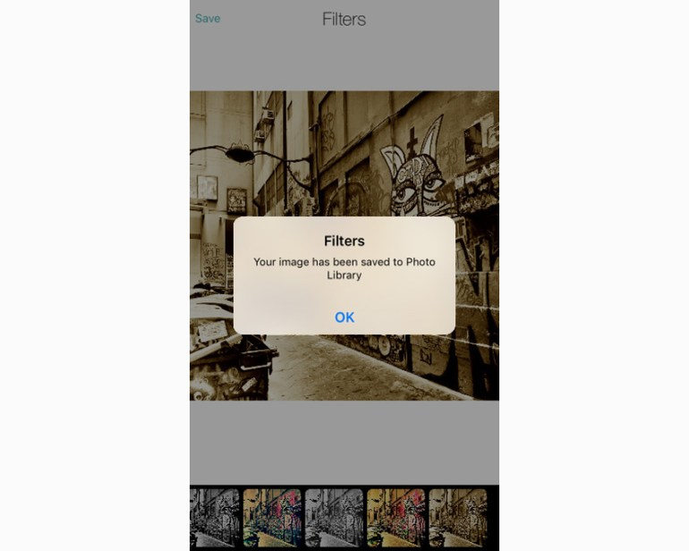 App showing message that image has been saved to Photo Library