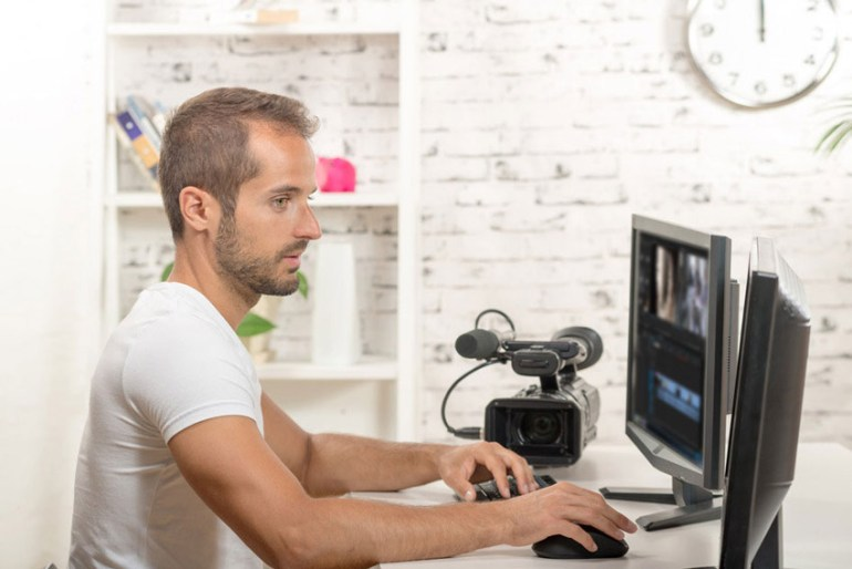Man editing on desktop computer
