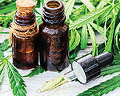 Cannabis oil vials and plant